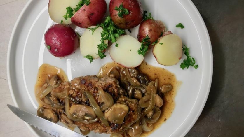 salisbury steak with mushroom gravy and potatoes