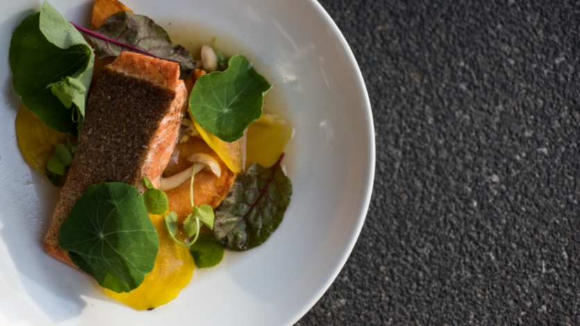 Steelhead salmon, nasturtium leaves and dashi on a plate at Black Sheep