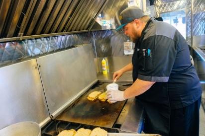 Cook on school food truck