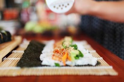 preparing a sushi roll