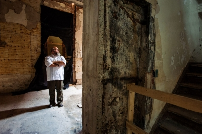 Chef Scott Schwartz stands amidst construction rubble in the Marble Bank Building