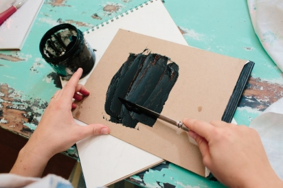 spread ink on a flat surface for a diy linoleum stamp