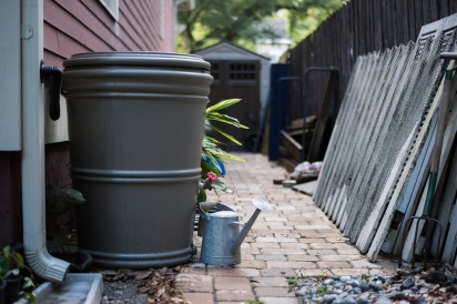 rain barrel and watering can