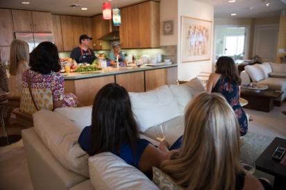 Women on couch near kitchen