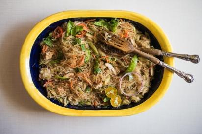filipino pancit noodles in yellow bowl
