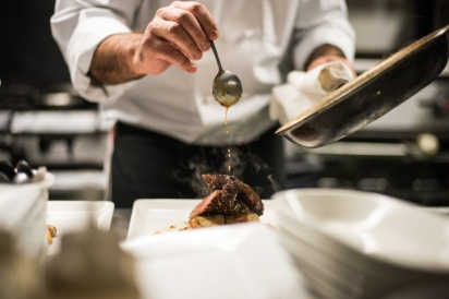 Plating a dish at Balefire Brasserie