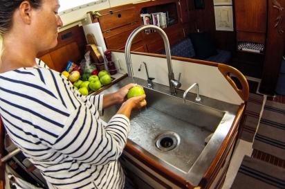 Lauren Weisenthal prepares food for storage in her galley kitchen