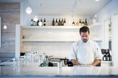 Kyle McBride works the garde at Restaurant Doro