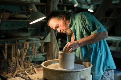 Bob Heim making pottery at Westside Studio