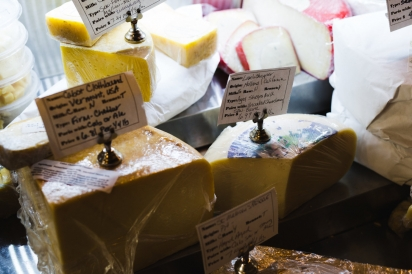 Cheese in display case at Grater Goods