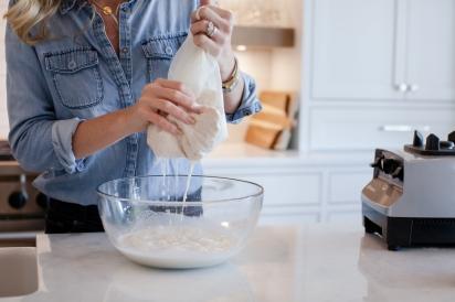 squeezing nut milk