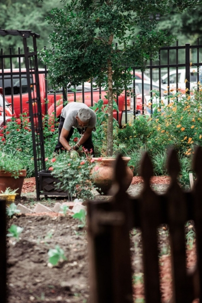 A man working in the garden at the Clara White Mission in Jacksonville Florida
