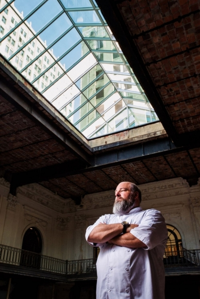 Chef Scott Schwartz stands under a glass ceiling in downtown Jacksonville at what will soon be the Bullbriar Restaurant