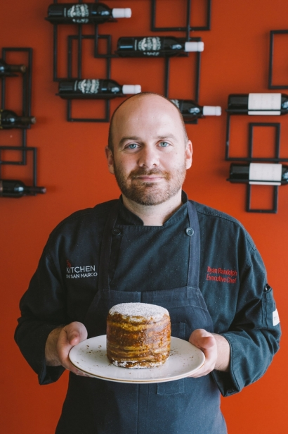 CHef Randolph holds stack cake