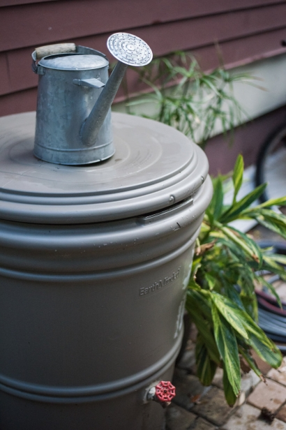 watering can and rain barrel