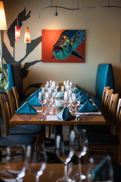 blackfly restaurant table setting with fish print on wall