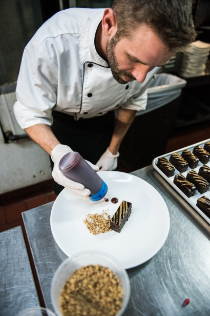Chef Matt Brown plating the chocolate torte dessert