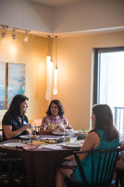 guests at vicarious kitchen sit at table