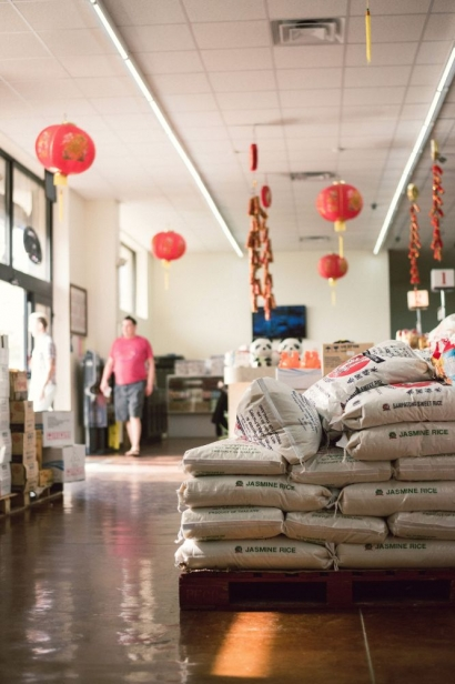 The entry way and bags of stacked rice at Hung Thinh in jacksonville florida