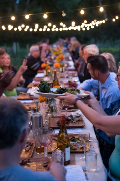 Passing food at farm dinner