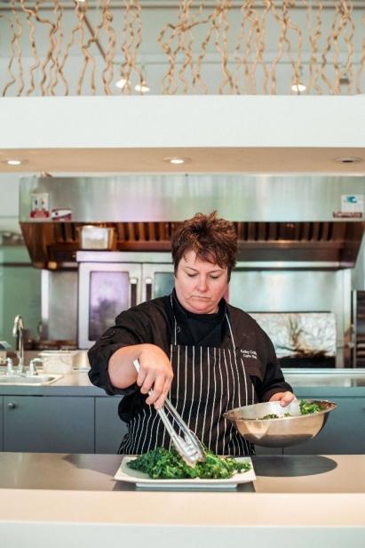 Kathy Collins Plating a dish at NOLA MOCA