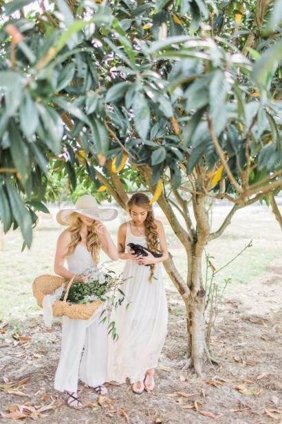 Conner Ann Waterman & Victoria Monronta standing under tree