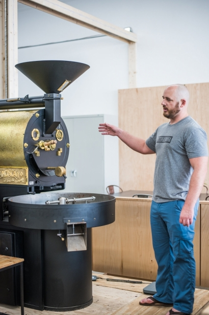 Spencer demonstrates coffee roaster