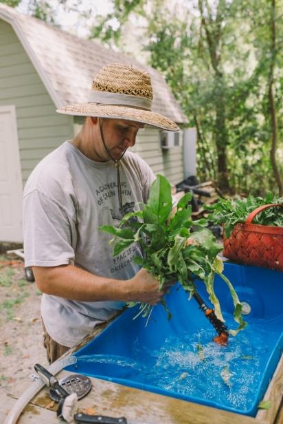 Ryan Lee washing greens.