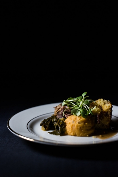 Smothered Pork Tenderloin with Collard Greens and Cornbread Croutons