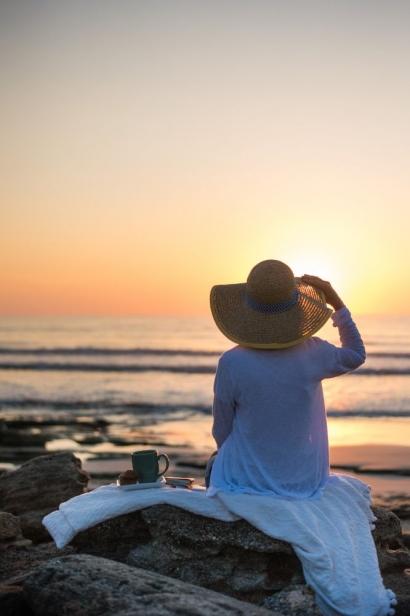 woman watching the sun set