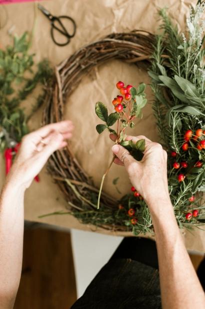 Adding Nandina to the wreath