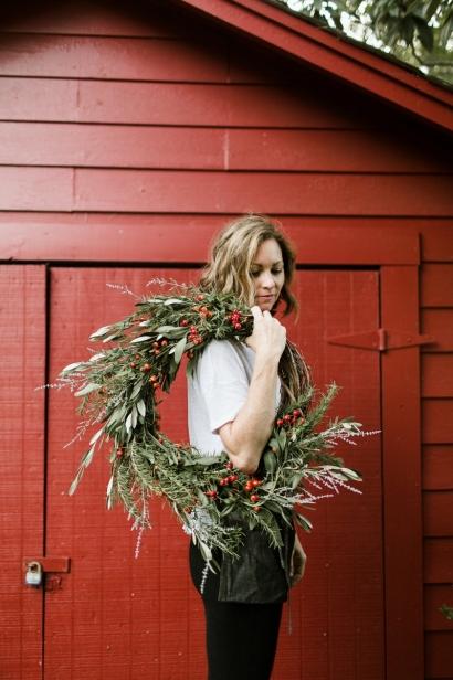 Becky Cardenas holding wreath.