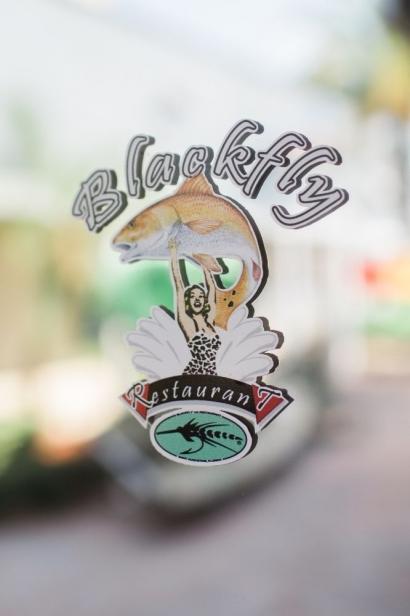 blackfly restaurant door sign