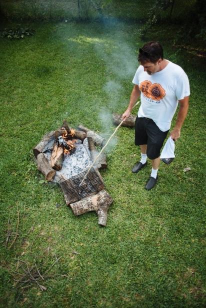 man building campfire ring