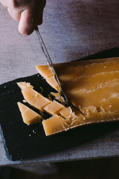 Cutting cheddar cheese