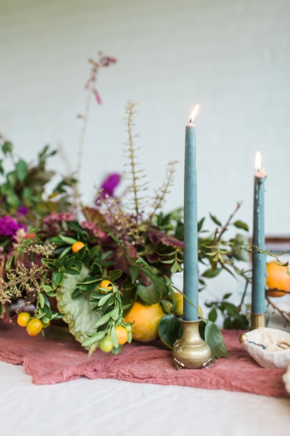 Foraged centerpiece and candles.