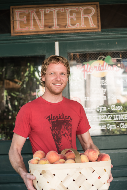 Jeff McNally of the Floridian in St. Augustine accepts a local delivery of peaches