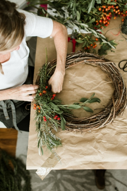 Making a wreath with foraged plants.