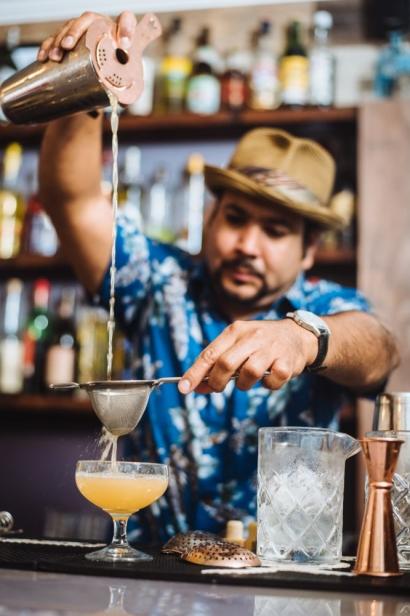 Cesar straining a drink