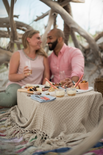couple picnic dining at the beach