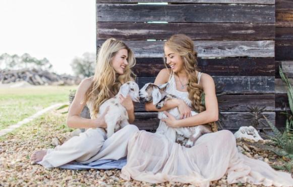 Conner Ann Waterman & Victoria Monronta holding goats