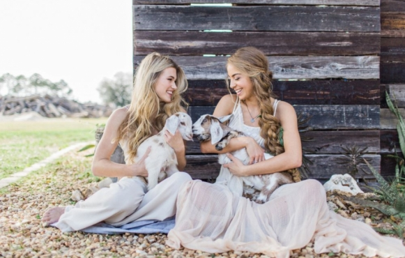 Conner Ann Waterman & Victoria Monronta holding goats
