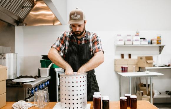 Chef Trey Hartingers making preserves at Congaree and Penn
