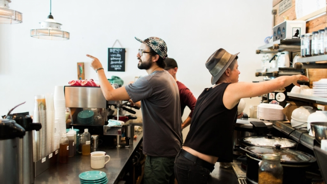 baristas at a coffee machine at Southern Roots Filling station