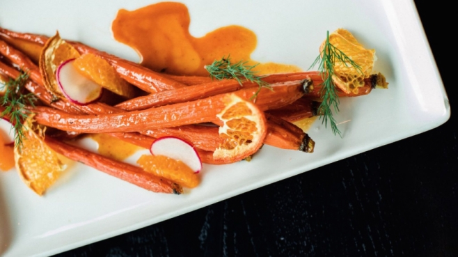 Sorghum Glazed Carrots close up on a plate