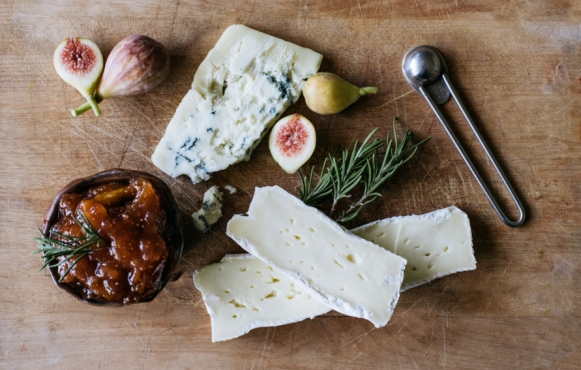 cheese rosemary and fig preserves on a cutting board