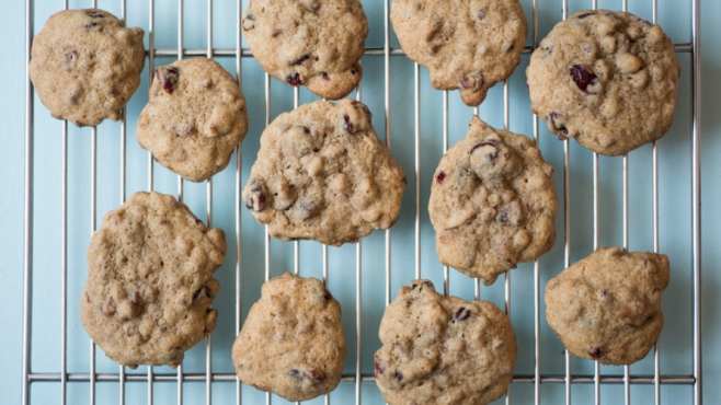 Cranberry pecan cookies on a blue background