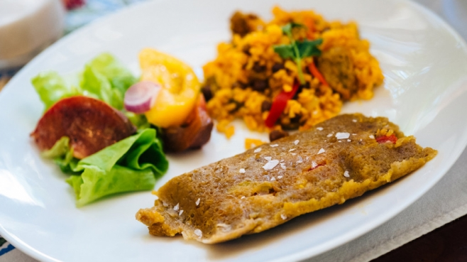 Pasteles and rice on a plate