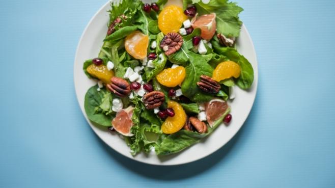 grapefruit salad on blue background
