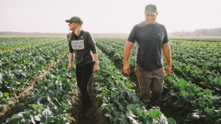 Megan DeJonge and Ben wells in the field at Ben Wells organic farm